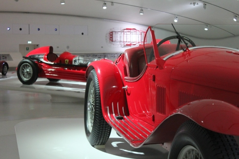 1932 Alfa Romeo 8C2300 Spider Corsa with the 1935 Alfa BiMotore behind.  Both products of the Scuderia Ferrari team.