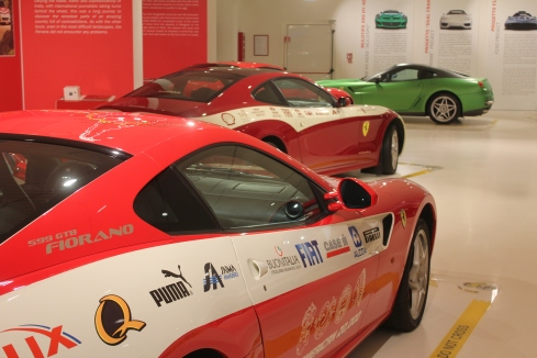Display of the 2008 India Tour and 2005 China Tour, 612 Scaglietti cars. In the back is the odd green colored 599 test vehicle for the HY-KERS electric motors.